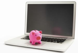 Piggy bank on laptop